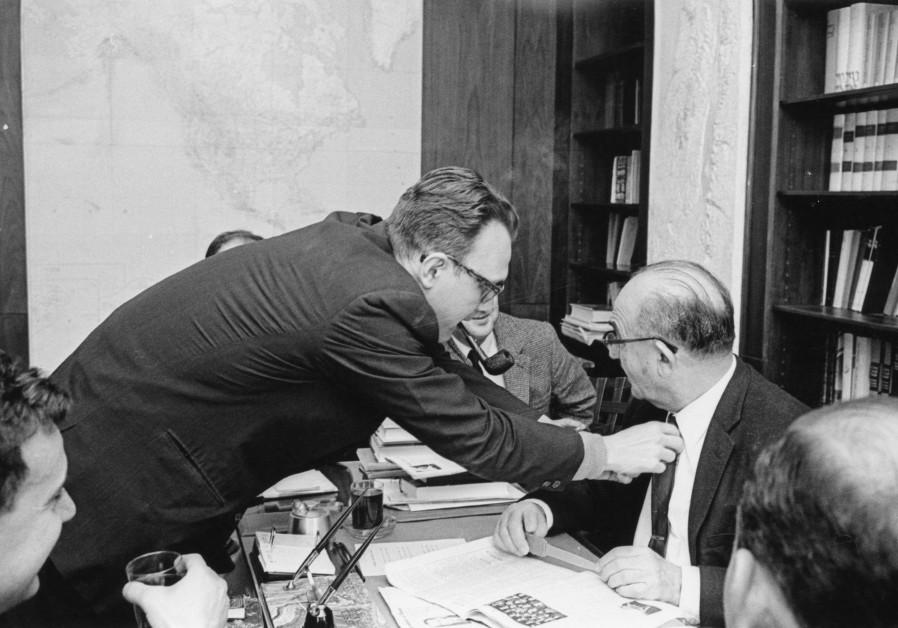 Avi-hai adjusts Levi Eshkol's tie in 1964. (Photo credit: Courtesy Avraham Avi-Hai)