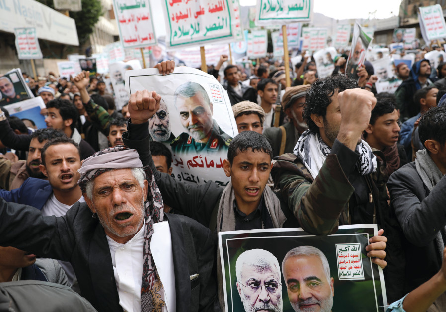 HOUTHI SUPPORTERS rally to denounce the US killing of Iranian military commander Qasem Soleimani and Iraqi militia commander Abu Mahdi alMuhandis, in Sana'a, Yemen, on January 6. The placards read, 'God is the greatest, death to America, death to Israel, Curse on the Jews, victory to Islam.' (Photo credit: Khaled Abdullah/Reuters)