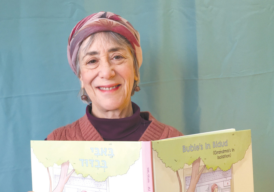 EDUCATOR KAREN GUTH holding her Bubie book, based on her own experiences. (Photo credit: Eric Guth)