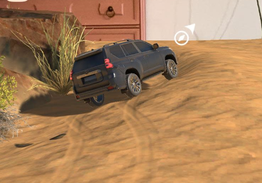 A Toyota Land Cruiser is seen swerving in an AR environment indoors. (Photo credit: Toyota Israel)