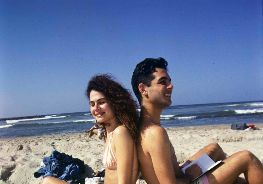 Catching some sun: On the beach, with masks in boxes, just in case of need. (Credit: IDF ARCHIVES DEFENSE MINISTRY AND WIND NOAM)
