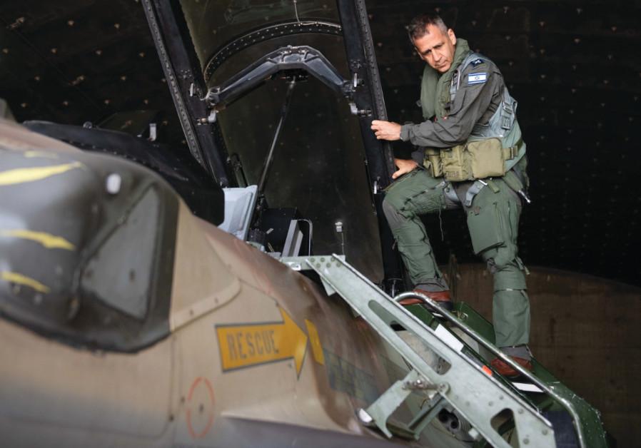 Kocahvi climbs into a cockpit during a recent flight on an F-16 (IDF Spokesperson's Unit)