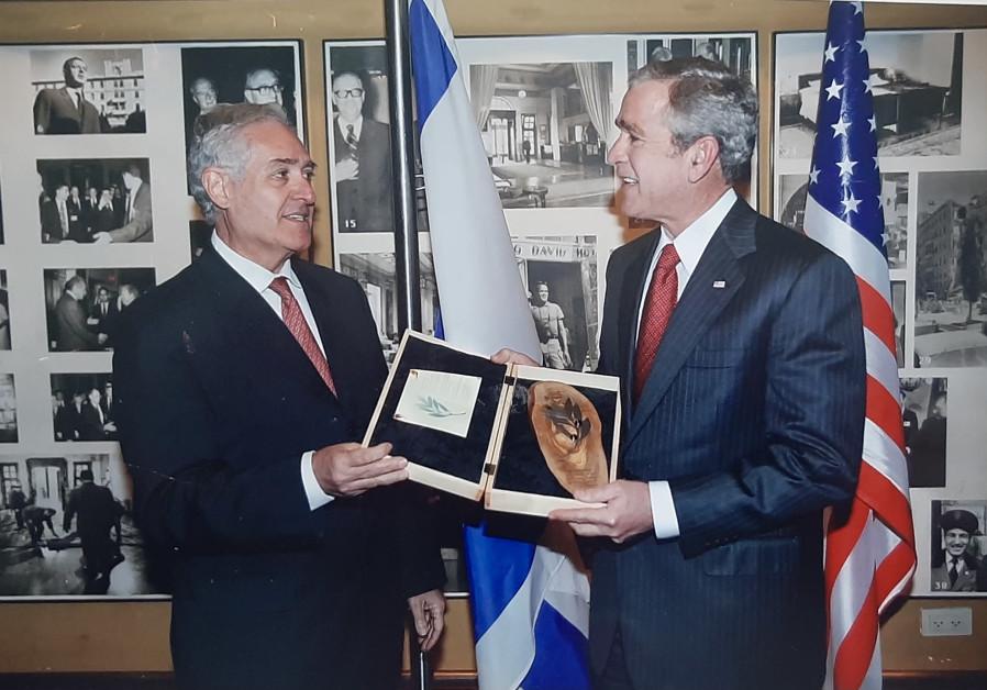 PRESIDENT GEORGE W. Bush receiving an olive tree gift from Eldan. (Ambassadors' Club of Israel)