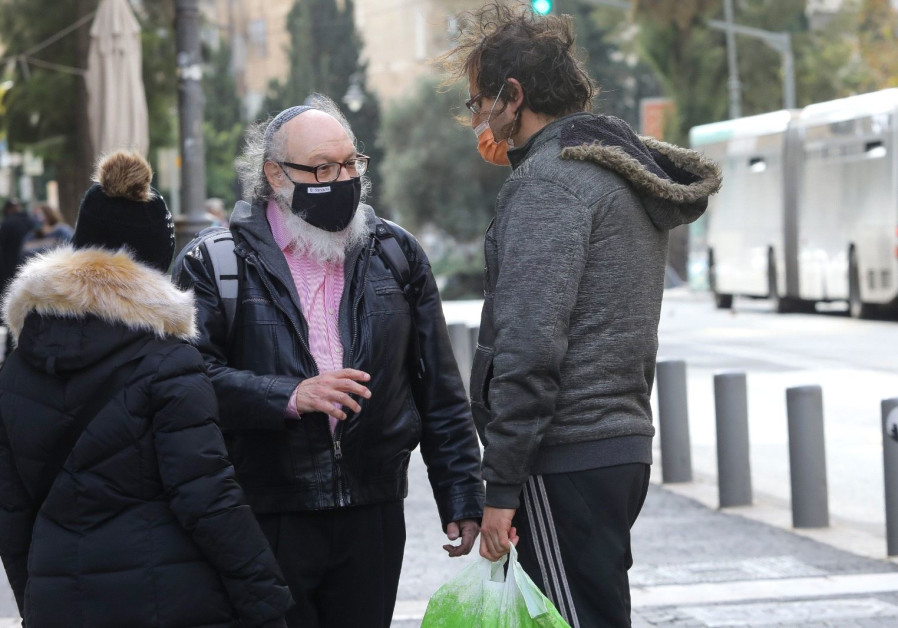 Pollard and his wife were seen walking down Ben Yehuda Street in Jerusalem (Marc Israel Sellem)