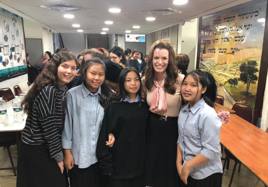 KEDMA DIRECTOR Orit Barnea Seif with Girls Town Hanukkah party participants. (Kedma)