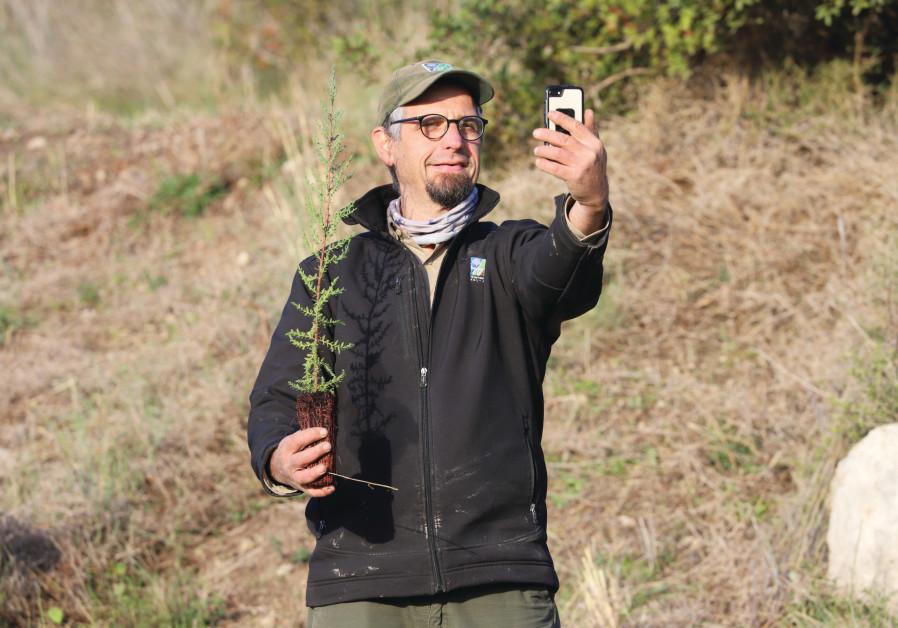 ERAN ZAVADI, KKL-JNF forester, conducts online tree planting via Zoom at Tzora Forest. (Yossi Aloni)