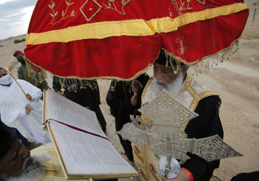 Ethiopia Archbishop Enbakom Basaznew conducting the epiphany ceremony by the Jordan River. (Igal Slavin)