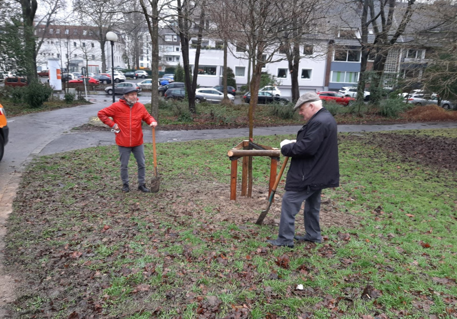 Dortmund's mayor Norbert Schilf (R) and Tzvi Rappaport (L) planting the symbolic six trees, January 28, 2021. (Credit: WORLD BNEI AKIVA)