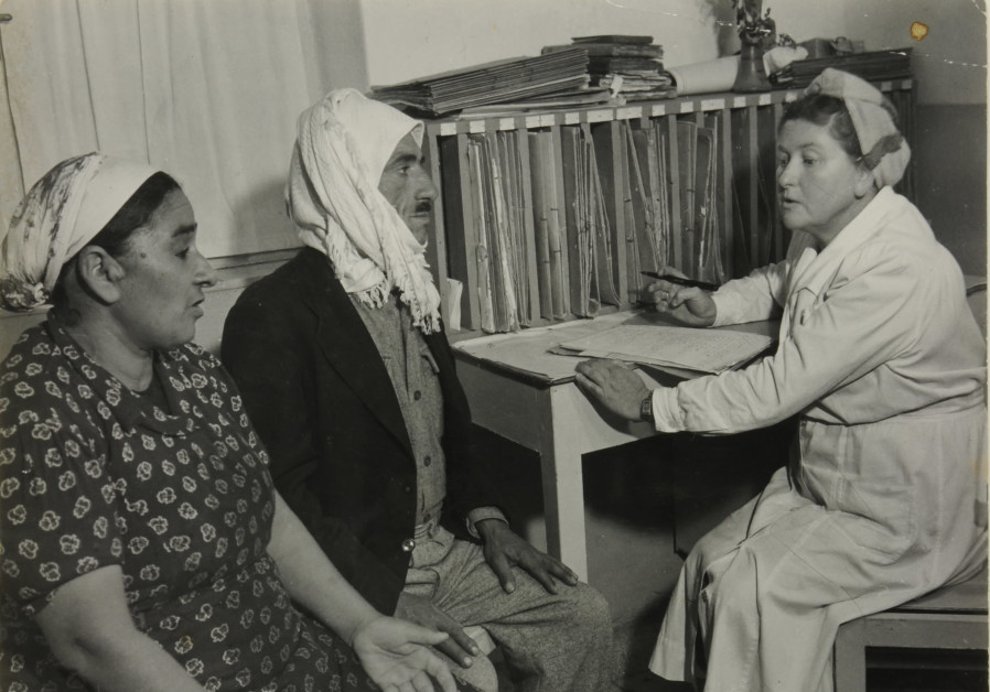New immigrants come for examination at the clinic, Alfred Bernheim, Israeli, born Germany, 1885-1974. This is a 1960s Gelatin silver print from The Israel Museum, Jerusalem, Alfred Bernheim Collection, acquired through the generosity of Warner Communications, New York. (Credit: ISRAEL MUSEUM'S PHOTOGRAPHIC ESTATE DEPARTMENT)