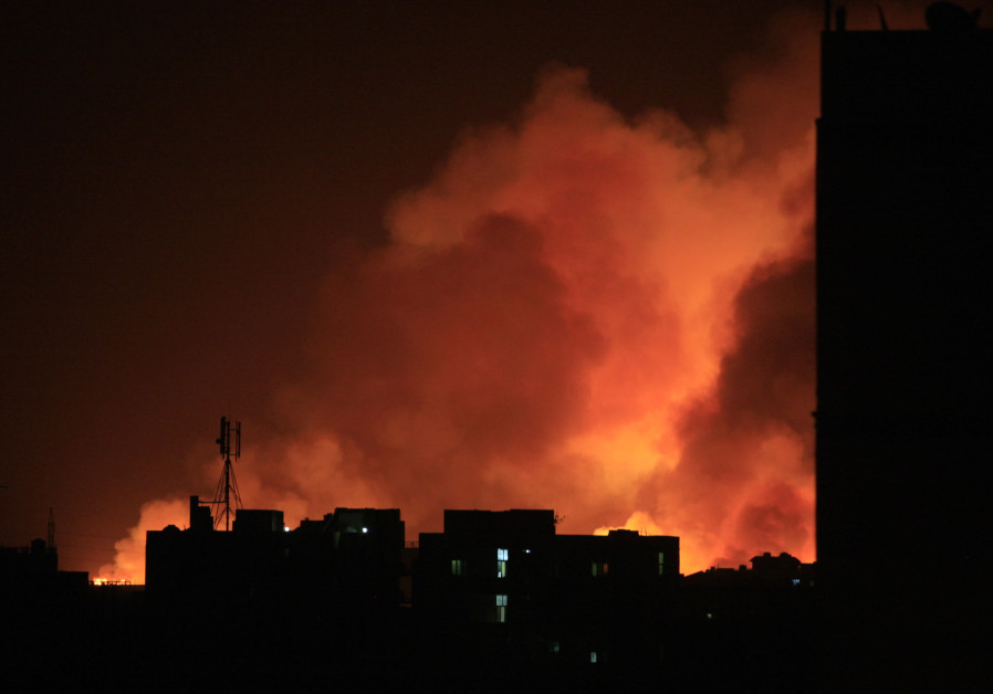 FIRE ENGULFS the Yarmouk munitions plant in Khartoum, October 2012. (Stringer/Reuters)