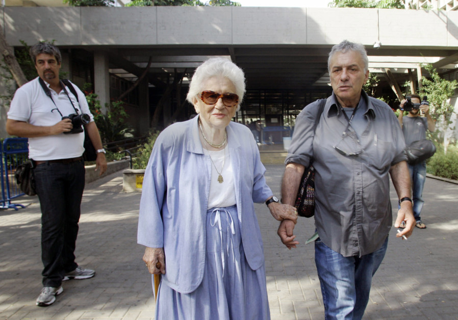 Son of Israeli general Moshe Dayan, Assi Dayan (R), with his mother Ruth Dayan after leaving  the Tel Aviv municipal court on charges of beating his girlfriend. Dayan received a 2000 shekel fine and one year parole. October 11, 2009. (Credit: URI LENZ/FLASH 90)