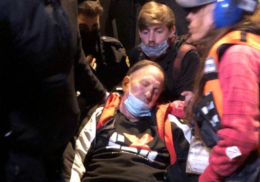 Asaf Agmon after losing consciousness during the Anti-Netanyahu protests in Jerusalem, Saturday, February 6, 2021. (Credit: Black Flags Movement)