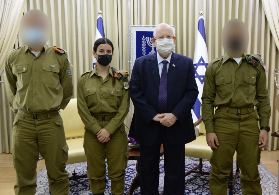 Israel's President Reuven Rivlin met with three soldiers who recently prevented terrorist attacks. (Credit: Mark Neiman / GPO)