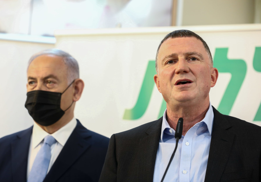 Health Minister Yuli Edelstein and Prime Minister Benjamin Netanyahu are seen speaking at a Clalit vaccination center in Zarzir, on February 9, 2021. (David Cohen/Flash90)
