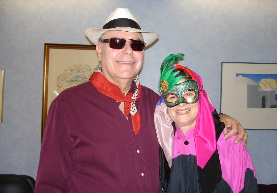 The writer and his wife, Annie, in Purim costume. (Photo credit: Courtesy)