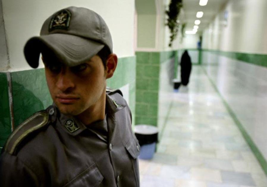 Champion Iranian bodybuilder stitched his lips to protest inhumane prison