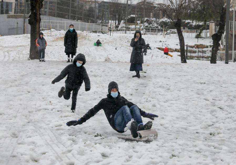 Snow in Gan Sacher, Jerusalem, February 18, 2021. (Credit: Marc Israel Sellem/The Jerusalem Post)