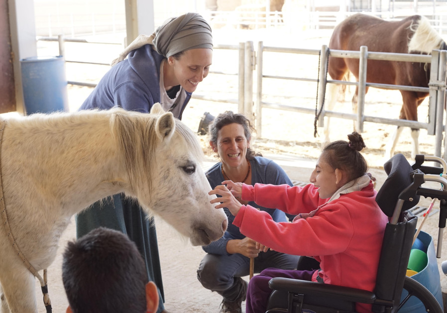 Caregivers at ADI Negev-Nahalat Eran use animal therapy to provide top quality care to residents of the village. (JNF-USA)