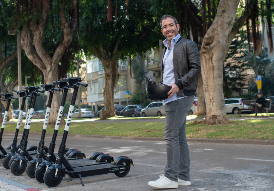 Yaniv Rivlin, CEO of Bird Israel, at a scooter station (Courtesy)