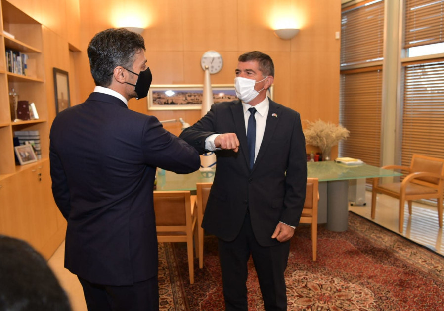 UAE Ambassador to Israel Muhammad Mahmoud Al Khafa and Israeli Foreign Minister Gabi Ashkenazi give each other the traditional coronavirus-era greeting of elbow bumping (Foreign Ministry)