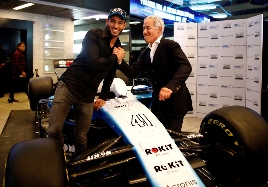 Adams congratulates Israeli racing driver Roy Nissany after signing with British Formula One motor racing team Williams on January 15, 2020 (Corinna Kern/Reuters)