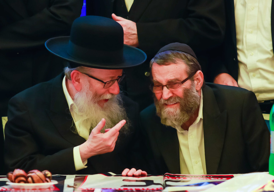 UNITED TORAH Judaism leader Moshe Gafni (right) with health minister Yaakov Litzman in party headquarters on election night, in Givat Shmuel on March 2, 2020. (Roy Alima/Flash90)