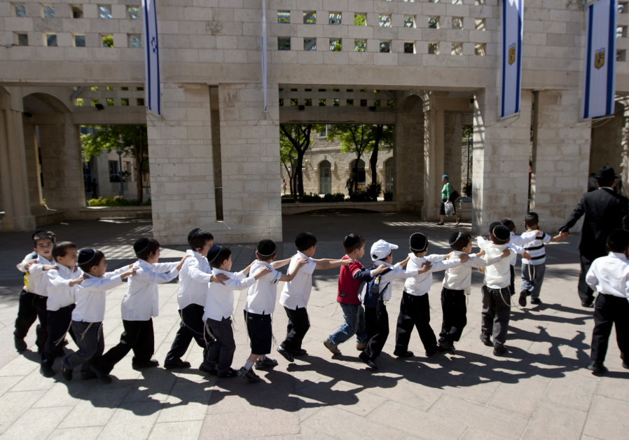 HAREDI CHILDREN march in a row in Jerusalem (in pre-corona times) – born into families with an average fertility rate of 6.6.  (David Vaaknin/Flash90)