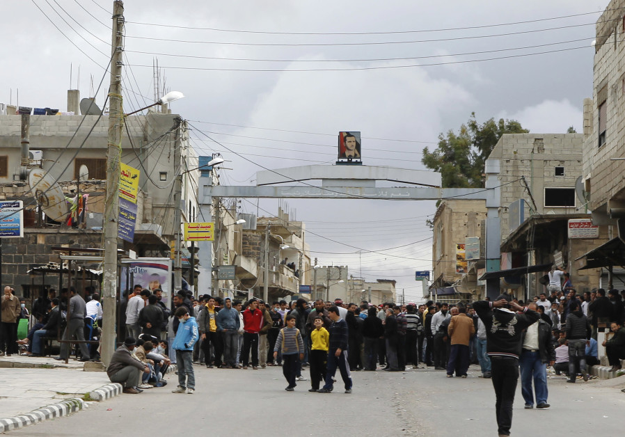"Protesters gather near the Omari Mosque in the southern old city of Deraa, March 22, 2011. Hundreds of people marched in southern Syria for a fifth straight day on Tuesday, protesting against the government of President Bashar al-Assad and shouting ""Freedom, freedom. Peaceful, peaceful."" Protesters gathered near the Old Omari mosque in Deraa and in the nearby town of Nawa in the strategic Hauran plateau, close to the border with Jordan, catching a wave of Arab unrest that has toppled leaders in Tunisia and Egypt. (Credit: REUTERS/KHALED AL-HARIRI)"