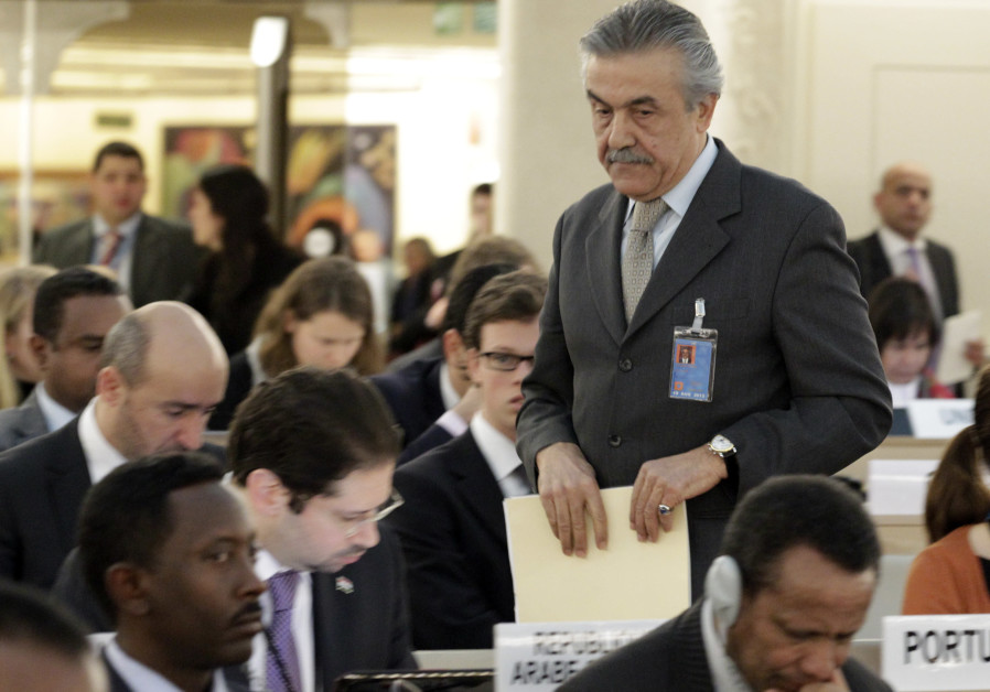 "Syrian ambassador to the United Nations Faysal Khabbaz Hamoui arrives at the UN Human Rights Council for the emergency debate on human rights and humanitarian situation in Syria, at the United Nations in Geneva February 28, 2012. Syria called on Tuesday for countries to stop ""inciting sectarianism and providing arms"" to opposition forces in the country, and charged that sanctions imposed by some countries were preventing Damascus from buying medicines and fuel. (Credit: REUTERS/DENIS BALIBOUSE)"
