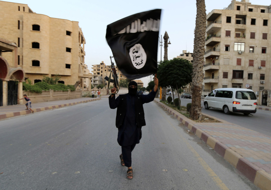 "A member loyal to the Islamic State in Iraq and the Levant (ISIL) waves an ISIL flag in Raqqa June 29, 2014. The offshoot of al-Qaeda which has captured swathes of territory in Iraq and Syria has declared itself an Islamic ""Caliphate"" and called on factions worldwide to pledge their allegiance, a statement posted on jihadist websites said on Sunday. The group, previously known as the Islamic State in Iraq and the Levant (ISIL), also known as ISIS, has renamed itself ""Islamic State"" and proclaimed its leader Abu Bakr al-Baghadi as ""Caliph"" - the head of the state, the statement said. (Credit: REUTERS/STRINGER)"