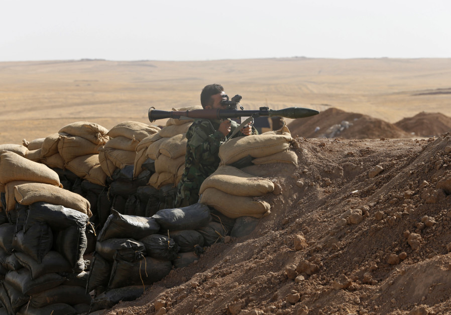 A Kurdish peshmerga fighter takes up position with a rocket-propelled grenade (RPG) launcher at the front line against the Islamic State, in Khazir September 7, 2014. Islamic State launched a lightning advance through northern and central Iraq in June, declaring an Islamic caliphate. With the help of US air strikes, Iraq's army and Kurdish forces have been able to push the fighters back from some areas. (Credit: REUTERS/AHMED JADALLAH)