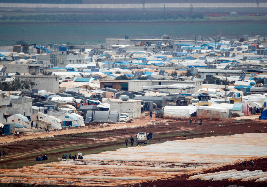 Tents housing internally displaced people in Atma camp in Idlib Governorate of Syria are seen on the Syrian side of the border zone near the Turkish village of Bukulmez in Hatay province, Turkey, February 24, 2020. (Credit: REUTERS/UMIT BEKTAS)