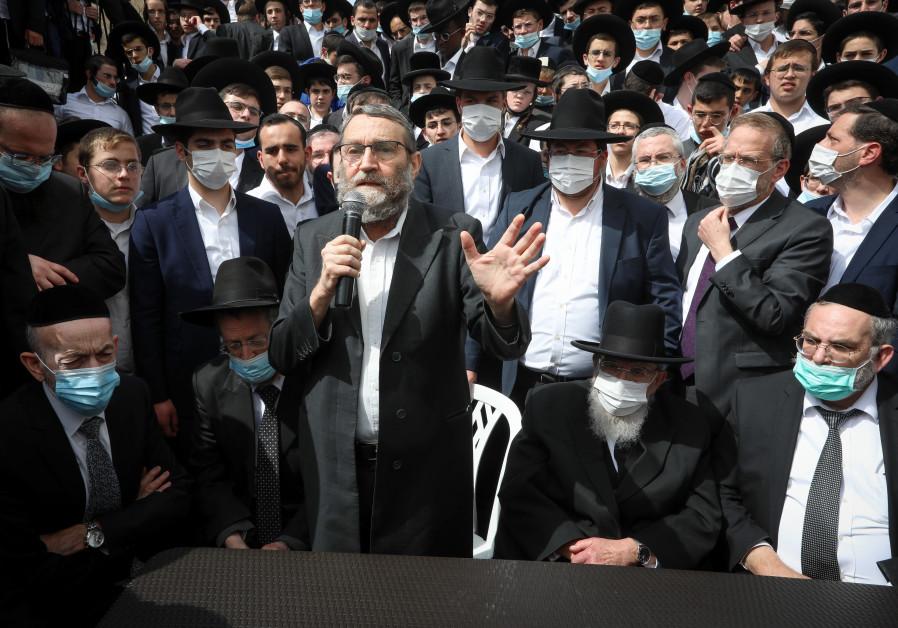 United Torah Judaism MK Moshe Gafni talks during a campaign stop in Beit Shemesh this week. (Photo credit: Yaakov Lederman/Flash90)