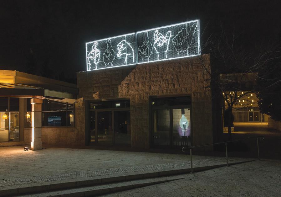 THE MULTILINGUAL neon Light creation references Jerusalem's ethnic interface. (Photo credit: Revital Topiol)