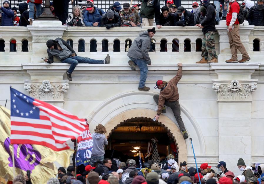Half of Republicans believe false accounts of deadly US Capitol riot