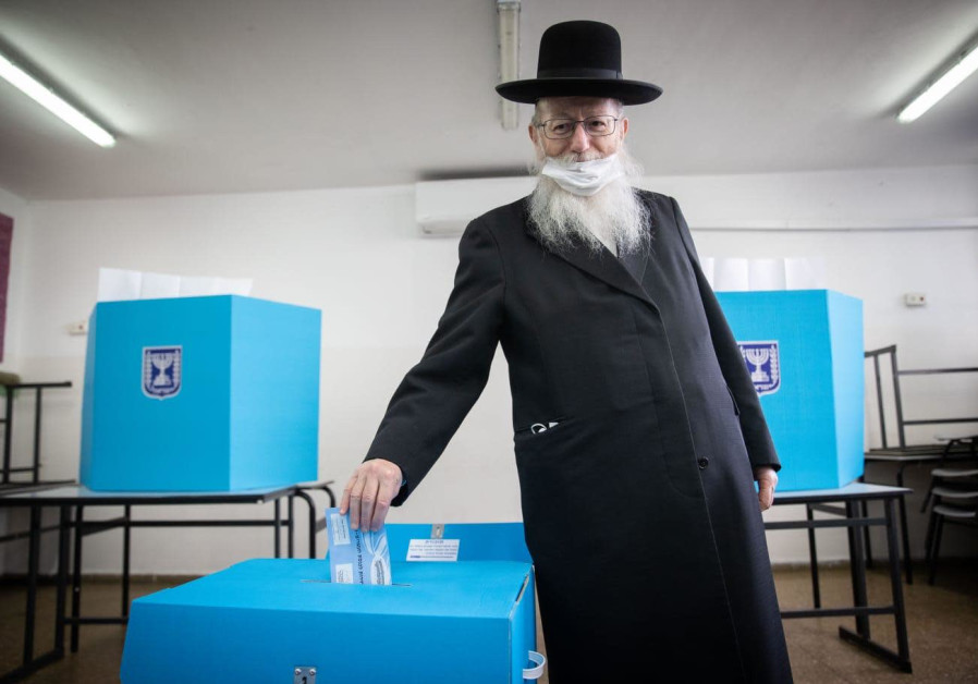 Construction and Housing Minister Ya'acov Litzman votes in Israel's March 23, 2021 election.