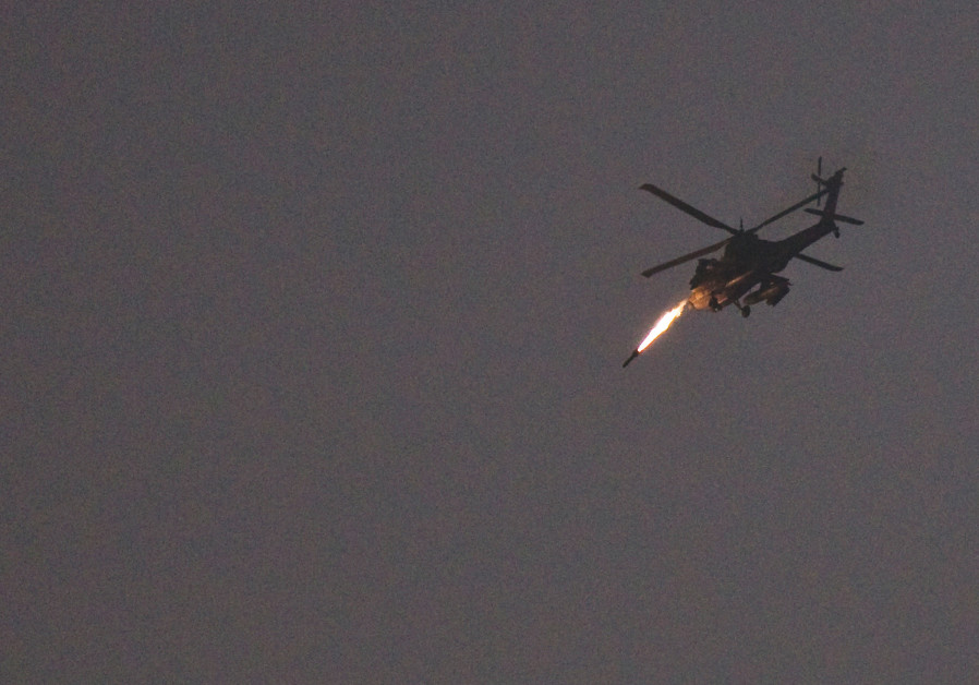 AN ISRAELI Apache helicopter fires a missile toward the Strip, July 2014. (Photo Credit: NIR ELIAS / REUTERS)