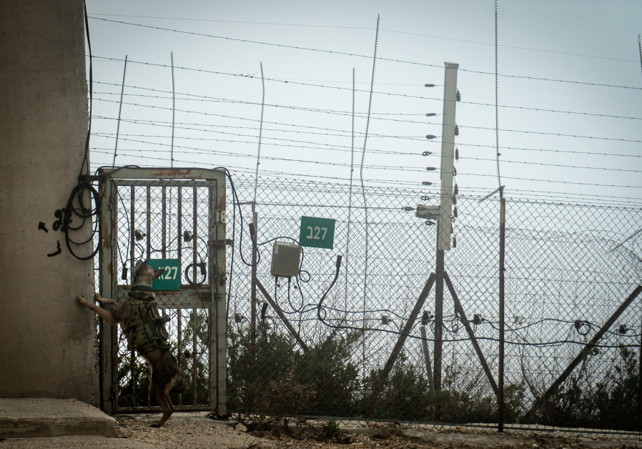 AN OKETZ dog checks that no IEDs were put on the gate before the force walks into the enclave. (Photo credit: IDF Spokesperson's Unit)