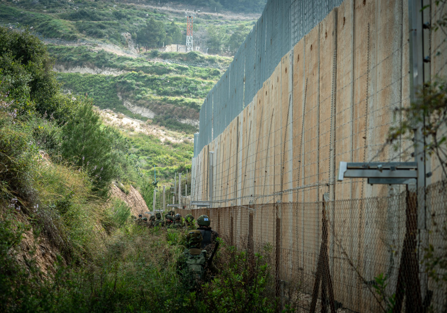 SOLDIERS WALK near the concrete wall, inside the enclave. (Photo credit: IDF Spokesperson's Unit)