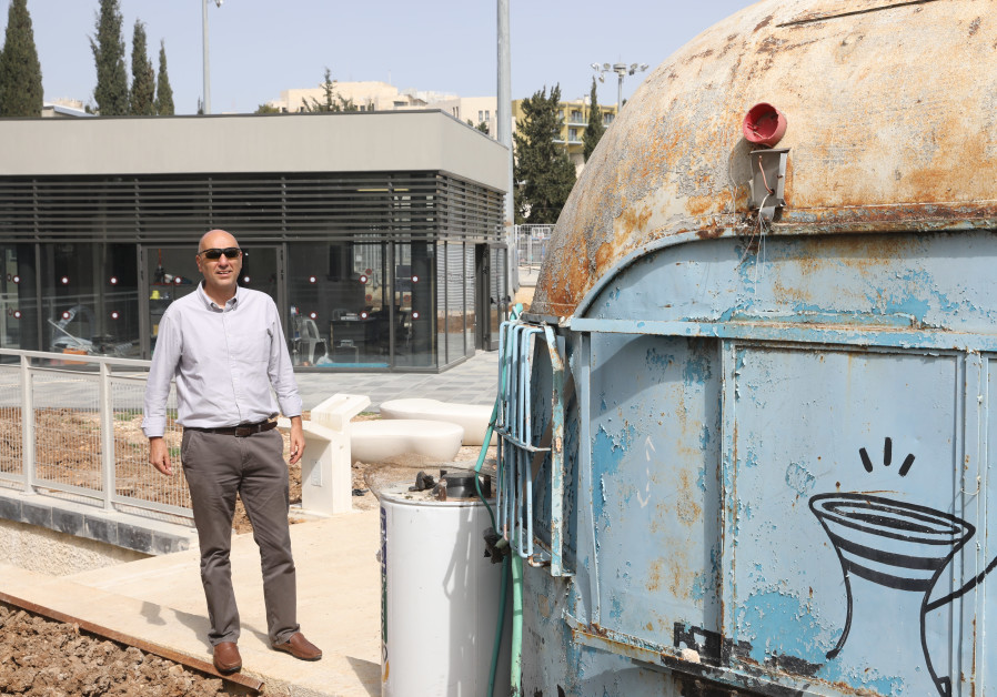 DORON OUTSIDE the original Train Theater with the new complex in the background (DORON OUTSIDE the original Train Theater with the new complex in the background (Photo Credit: Marc Israel Sellem)