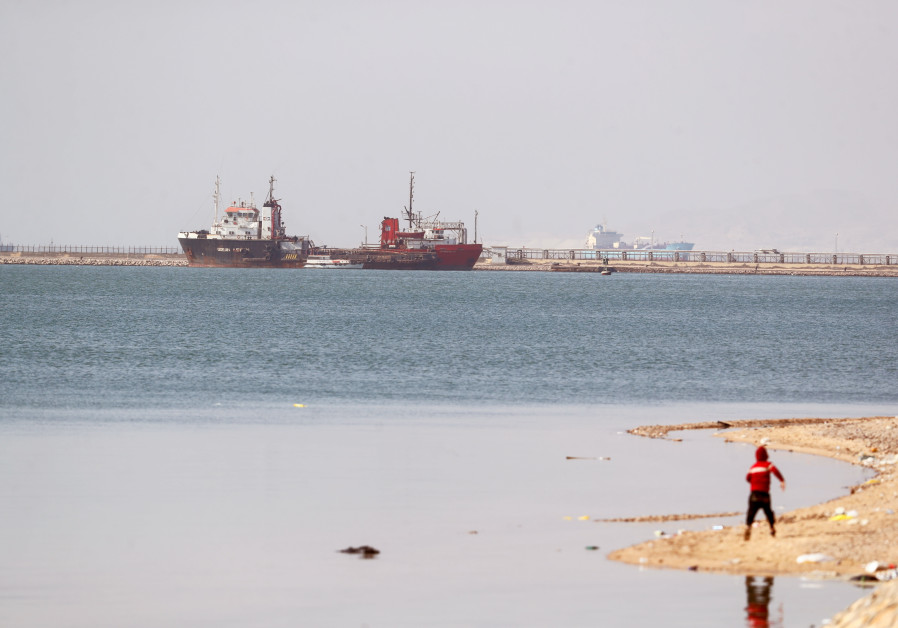 Ships are seen at the entrance of the Suez Canal, Egypt March 26, 2021. (Photo credit: Mohamed Abd El Ghaney/Reuters)