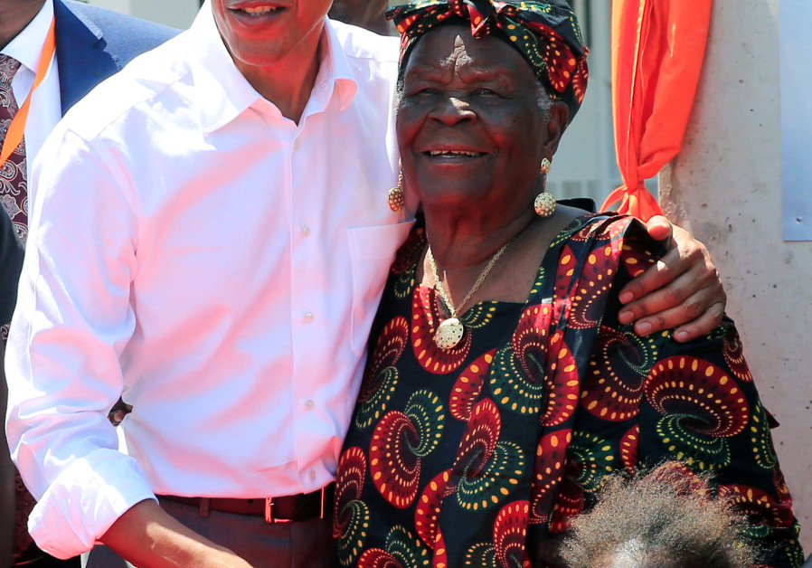 Former US President Barack Obama embrace his grandmother Sarah Obama at the Sauti Kuu resource centre near his ancestral home in Nyangoma Kogelo village in Siaya county, western Kenya July 16, 2018. (Credit: REUTERS/THOMAS MUKOYA)