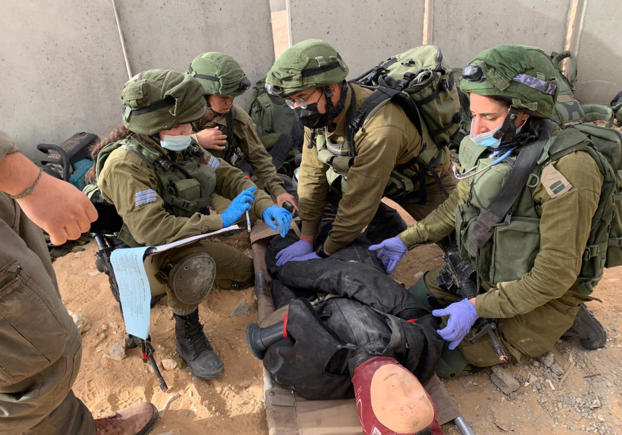 IDF soldiers are seen around a practice dummy during an exercise simulating a rescue mission behind enemy lines. (Photo credit: IDF Spokesperson's Unit)