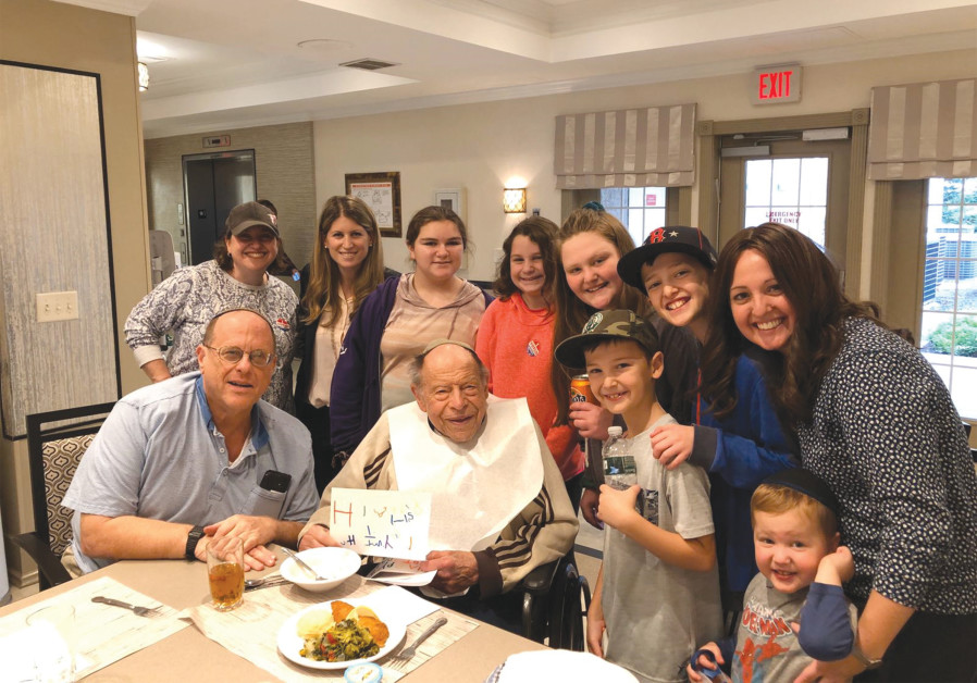 MORRIS ZIMMERMAN with some of his younger friends and neighbors, including his shul rebbetzin, on his 94th birthday  (Photos: Courtesy those mentioned)