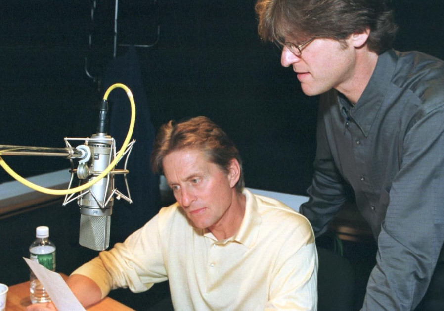 ACTOR MICHAEL DOUGLAS and Richard Trank, writer/director and executive producer for Moriah Films during the narration of 'In Search of Peace,' 2000. (Photo credit: Simon Wiesenthal Center)