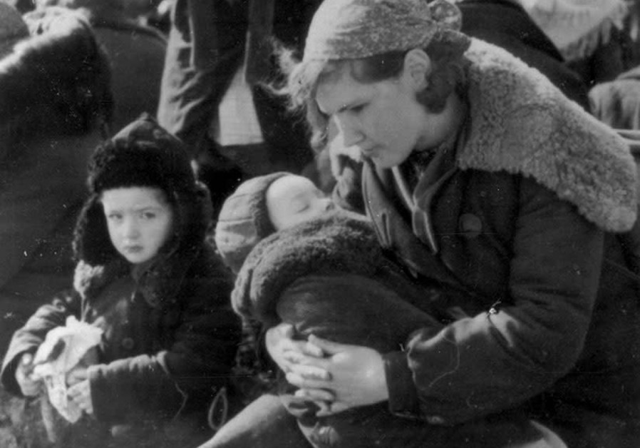A MOTHER and her children before execution in Lubny, Ukraine, October 1941 (Yad Vashem Archives)