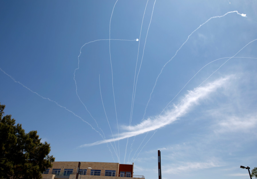 TRAILS ARE seen in the sky as an Iron Dome projectile intercepts a rocket fired from Gaza, above Ashkelon in May 2019. (Photo Credit: AMIR COHEN/REUTERS)