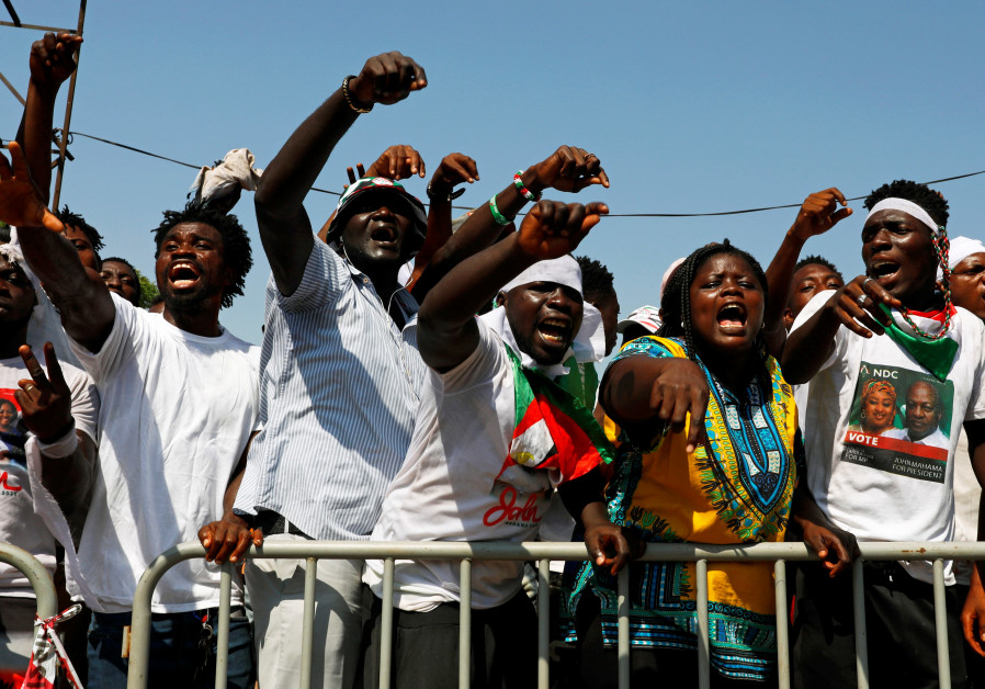UPPORTERS OF the NDC opposition party protest outside Ghana's Electoral Commission ahead of the official declaration of results, in Accra on December 9, 2020. (FRANCIS KOKOROKO/REUTERS)