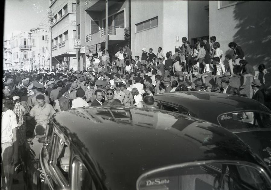 Crowds celebrating the declaration of the State of Israel in the streets of Tel Aviv, May 14, 1948. (Credit: BENO ROTHENBERG/FROM THE MEITAR COLLECTION/COURTESY OF THE STATE ARCHIVE/AVAILABLE VIA THE NATIONAL LIBRARY OF ISRAEL)