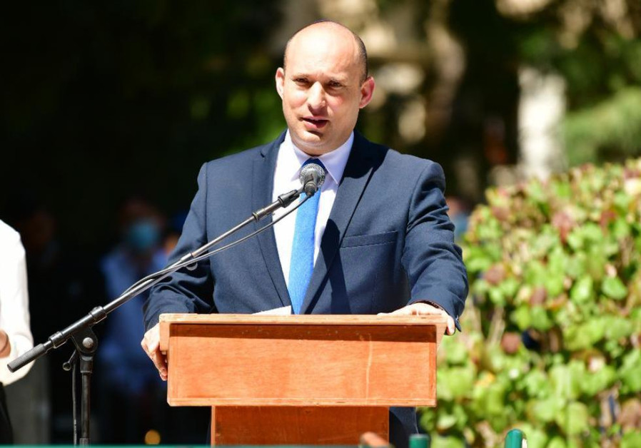 Yamina head Naftali Bennett spoke at a Remembrance Day ceremony in the Kfar Saba military cemetery on April 14 2021 (Photo Credit: MICHAEL KATZ)